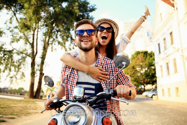 53536689 - couple in love riding a motorbike